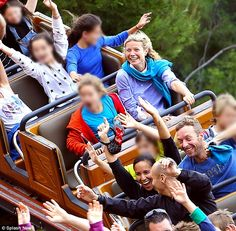 Family fun day: Gwyneth Paltrow and Chris Martin rode the roller coaster with daughter App...