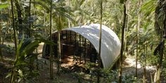 """SHARING IS CARING!0000Using the Prefab Philosophy of a Ship…  A semi circle hut in the middle of the Brazilian Atlantic Forest is truly an eye catching spot to rest after a long day of exploring. ARCA (""""Ark""""), as it's called by the locals, is a remarkable project by architect Marko Brajovic, that was a …"""
