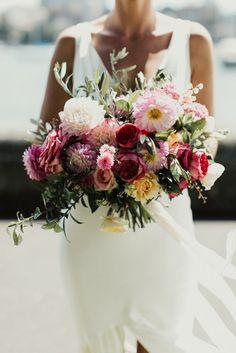 vibrant pink dahlia weddng bouquet