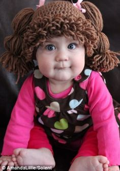 Wiggle: A baby girl dressed up as Cabbage Patch Kid wearing Amanda's wig