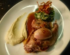 Roast rabbit, black-cabbage & crushed potato, parsnip puree with a rich rabbit jus