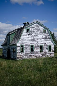 """""""Barn"""" by James.Ireland on Flickr - According to the photographer there are four old barns off the Trans Canada just outside the city.  He saw them on the way to Kananaskis Country and thought they might be interesting to photograph.  This photo that was taken in Canada on August 7, 2011 shows one of those barns."""