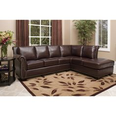 This Burgundy sleek leather sectional sofa will be as comfortable in your living room d�cor as you will be on its resilient foam cushioning. Made from Italian top-grain leather and brass nail heads, the stunning design is sure to be eye catching.