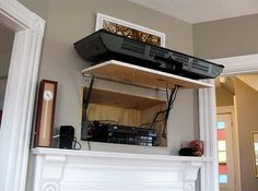 With a tiny compartment tucked behind the tv unit, all unsightly wires and boxes are kept out of mind.
