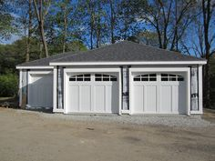 Haas American Tradition model 921 Steel Carriage House Style Garage Doors in White with Arch 6 Pane Glass. Installed by Mortland Overhead Door. mortlanddoor.com