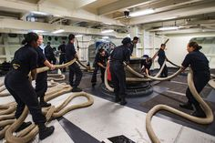 Sailors haul in mooring lines during a sea-and-anchor evolution aboard the aircraft carrier USS Ronald Reagan in Yokosuka, Japan, Aug. 18, 2016, after returning from inspection and survey testing at sea. The sailors arrange the lines in a side-by-side pattern to help prevent the ropes from getting tangled in their legs. The Reagan provides a combat-ready force to protect and defend the collective maritime interests of the United States and its allies and partners in the Indo-Asia-Pacific…