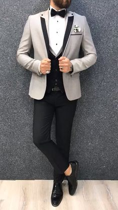 Collection: Spring – Summer 2019 Product: Slim Fit Tuxedo Color Code: Gray Size: Suit Material: 70 viscose, 30 polyester Machine Washable: No Fitting: Slim-fit Package Include: Jacket, Vest, Pants Only Gifts: Shirt, Chain and Bow Tie Mens Casual Suits, Dress Suits For Men, Stylish Mens Outfits, Suits For Groom, Mens Suits, Casual Outfits, Blazer Outfits Men, Mens Fashion Blazer, Suit Fashion