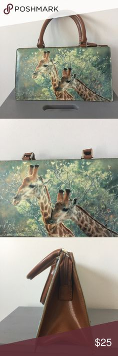 "Giraffe photo doctor Handbag purse green brown Preowned doctor style Handbag purse Giraffe photo on both sides. Zipper top closure. Zipper pocket inside. Handles. Excellent condition. Measurements are approximate. Length almost 12"" Height almost 6"" width on bottom 4"" handle drop 5 1/4"" Bags Totes"