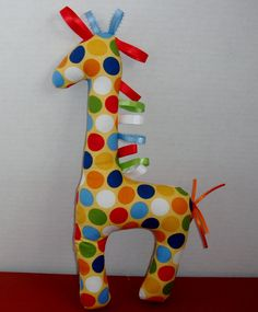 Rag-tag giraffe toy. Brilliant fabrics!