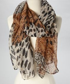 Add+a+touch+of+the+jungle+to+everyday+style+with+this+chic+scarf.+Its+fierce+mix+of+animal+prints+and+bold+style+make+it+the+perfect+addition+to+any+closet.