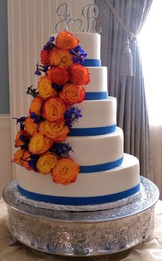 Orange and blue wedding cake. #autumn colors Like the blue and change the flowers @Lacie Norman Norman Marie