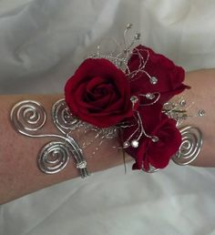 Red and silver corsage. I would like a few more flowers and some greenery though.