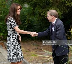 Catherine, Duchess of Cambridge greets Paul Farmer as she attends an event hosted by Mind at Harrow College to mark World Mental Health Day on October 10, 2015 in Harrow, England.