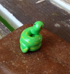A personal favorite from my Etsy shop https://www.etsy.com/listing/290054961/miniature-polymer-clay-animal-snake