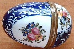 Staffordshire enamel nutmeg grater, decorated with a blue background below white enamel, leaf floral, scroll and shell designs.