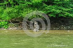 Pile of stones set in the middle of a mountain river