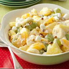 Ambrosia Fruit Salad                                                 2 cups cubed fresh pineapple 2 large California Navel Oranges, peeled and sectioned 1-1/2 cups green grapes 1 cup miniature marshmallows ...