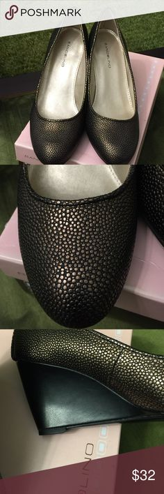 Bandolino Pebble Brass Leather Wedge This shoe is NEW in the box. The rich bronze/brass color can be worn with so many color families. Shoe has a approx. 3 inch wedge heel. Rounded toe . Excellent condition. Bandolino Shoes Wedges