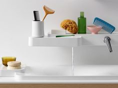 A new bathroom fixtures collection with more than 85 items designed by the Bouroullec brothers features this innovative washbasin combination above - with a faucet and spout built into a wall-mounted shelf.