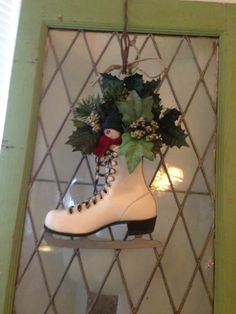 Door decor I made for Christmas out of an old skate. This was sold .