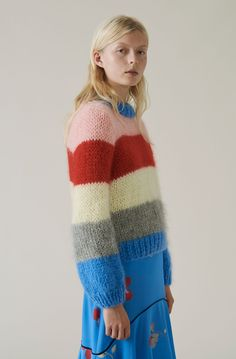 Exclusive hand-knitted pullover knitted by local women from the South of Tuscany in Italy. The production is run by a family-owned business. It takes each woman three days to knit one sweater, and due to the hand-knitting process all pieces are unique. The chunky pullover features a round neckline, wide sleeves and an oversize fit.