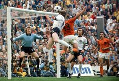 Berti Vogt of West Germany heads the ball as Dutchman Johan Cruyff and teammate Franz Beckenbauer look on in the 1974 World Cup. Fifa, 1974 World Cup, Germany Football, International Football, World Cup Final, Soccer Stars, School Football, Goalkeeper, Sports Illustrated