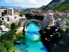 century bridge in Mostar, Bosnia and Herzegovina.only part of Mostar that actually looked nice. The rest was destroyed and full of bullet holes Places Around The World, Oh The Places You'll Go, Places To Travel, Places To Visit, Around The Worlds, Voyage Montenegro, Montenegro Budva, Montenegro Travel, Dream Vacations