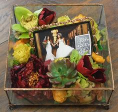 Preserved succulents, orchids, peony, tulips and roses in Floral Keepsakes' custom glass box.