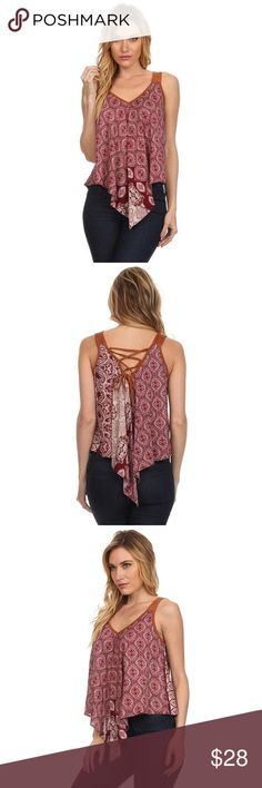 💕Sleeveless Suede Look Accented Top This sleeveless asymmetric top has a billowy fit with tons of comfort. It features handkerchief hem, contrast paisley border print, super soft Suede look trim and v-neckline with a self-tie crisscross back closure.100% Rayon. Focus On Life Apparel Tops
