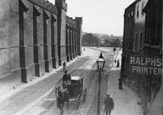 A horse and carriage travelling into the city along Tower Street in the 1890s. The towering walls of York prison are on the left. Photo: Imagine York