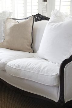 couch, upholstered in white linen