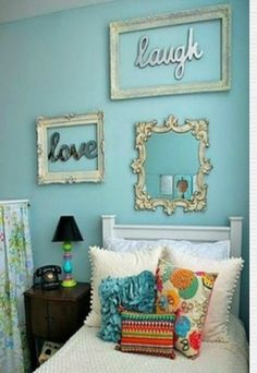 wooden letter with frames, that mirror, and wall color are perfect :)