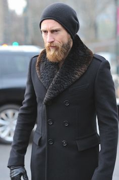 Russian Style Coat with fur collar and bearded man.