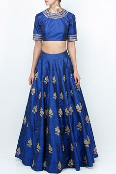 Featuring a cobalt blue mid-waist flared lehenga skirt in raw silk with antique gold zari and sequin embroidered floral motifs all over. It is paired with a matching blouse with gold zari and sequin work around neckline and on sleeves. It has back zip closure.   Fabric: Raw silk  Care Instructions: Steam press and dryclean only.