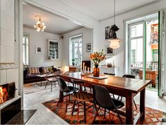 dining table with Eames chairs and carpet