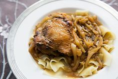 Chicken thighs with onions, browned in butter and braised in dark beer and chicken stock, for a rich, savory stew.  Chicken carbonnade.