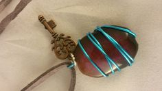 Fuchsia AgateWrapped In Blue Wire With Burnt Copper Key Charm