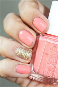 Salmon pink nails, with glitter accents