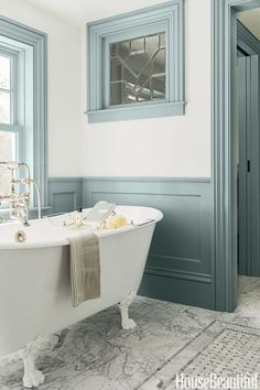 Old-World Wainscoting: Architect Michael T. Gray and interior designer Hattie Holland carved a master bath out of a hallway and added wainscoting and window casings to create a sense of the past. Click through for more master bath ideas!