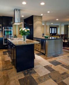 Contemporary Kitchen with small black and white tile accent wall
