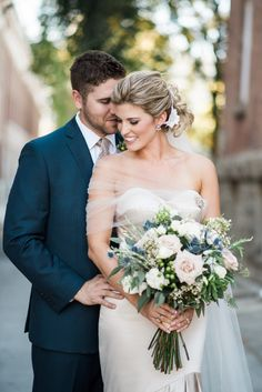 Classic wedding photo idea - bride + groom with lush bouquet {Photo by E + E Photography}