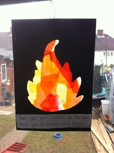 Moses and the burning bush craft - laminating pouch, tissue paper, black card, ribbon.