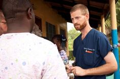 Handout photo of Dr. Kent Brantly speaking with colleagues at the case management center on the campus of ELWA Hospital in Monrovia.