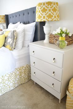 Gray, Yellow and White Bedroom with gray upholstered headboard, yellow trellis bedskirt and lamps and painted nightstands - Sarah M Dorsey Designs