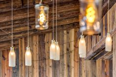 These milk bottle pendant light fixtures offer a authentic look to this mountain top restaurant in the French Alps.   Decorative pendant lighting in this dining space.   #milkbottle #milkbottlelighting #pendantlighting #uniquelighting #uniquelights #lightingideas #vintagelighting #vintagelights #rusticlighting #lightingdesign #restaurantdesign #diningdecor #interiordesign #interiorlighting #rusticstyle #vintageinteriors #hanginglights #pendantlights Vintage Pendant Lighting, Contemporary Pendant Lights, Rustic Lighting, Unique Lighting, Lighting Ideas, White Pendant Light, Glass Pendant Light, Pendant Light Fixtures, Vintage Milk Bottles