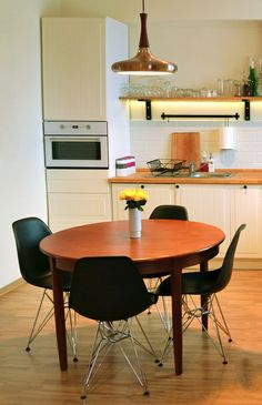 Kitchen in scandinavian style. Teak table, dsr black chairs, white brick tiles, open shelves, cream/ecru walls. Maszroom.com