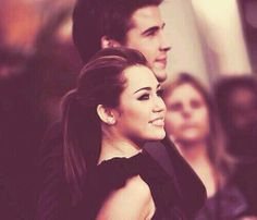 Miley Cyrus and Liam Hemsworth  I LIKED HER THE WAY SHE WAS WITH HER HAIR AND WHEN SHE WAS IN THE LAST SONG.......... BUT I DONT LIKE HER NOW UGGGG SHE IS GROSS.... I WISH SHE WOULDNT OF WENT LIKE THIS ALL WERID AND EVERYTHING AND HER AND LIAM STAY TOGETHER THEY WERE SOOO CUTE