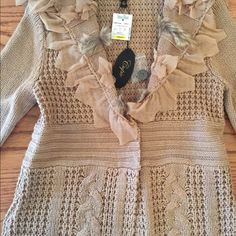 🎉Lowest!New tan knit long sweater w faux fur trim Such a great price! If I didn't have another one so similar,I'd hang onto it! Cute,warm sweater than can be worn with a variety of colors and styles. Cupio Sweaters