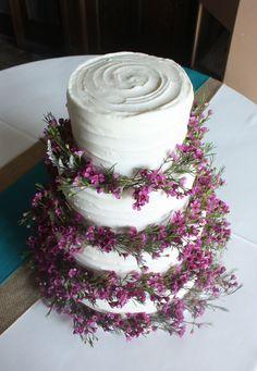 Purple Wax Flowers on Rustic Wedding Cake