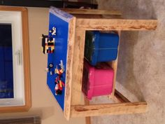 Lego table made from reclaimed wood.  Flips over to wood side for coloring etc.